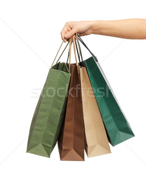 Nő kezek tart bevásárlótáskák közelkép kéz Stock fotó © dolgachov
