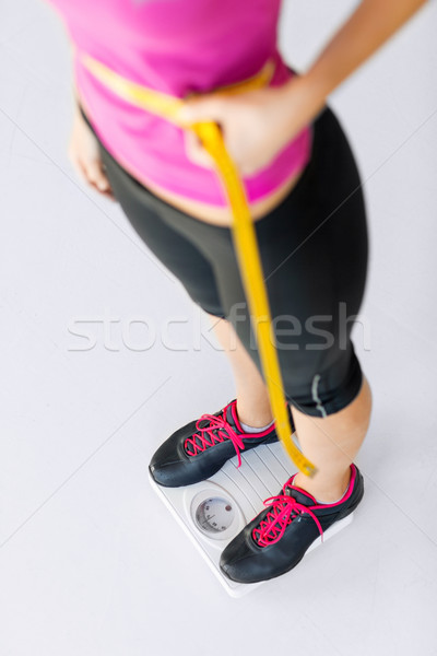trained belly with measuring tape Stock photo © dolgachov