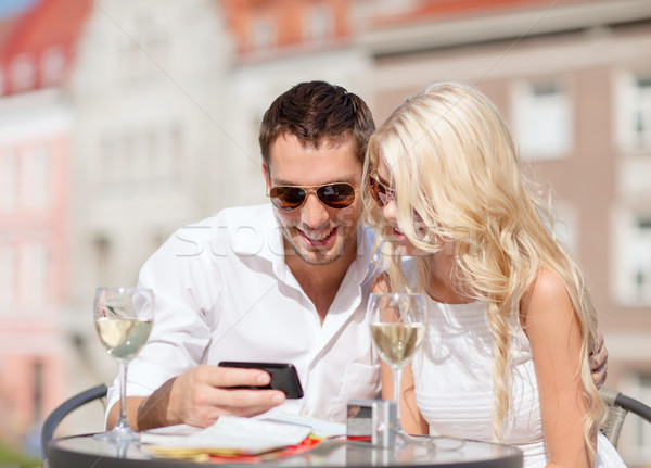 couple looking at smartphone in cafe Stock photo © dolgachov