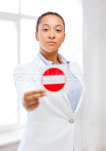 african woman showing stop sign Stock photo © dolgachov