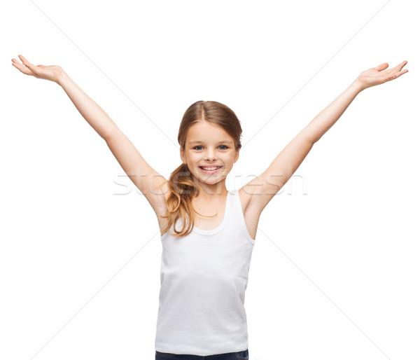 Sorridente as mãos levantadas camisas projeto felicidade Foto stock © dolgachov