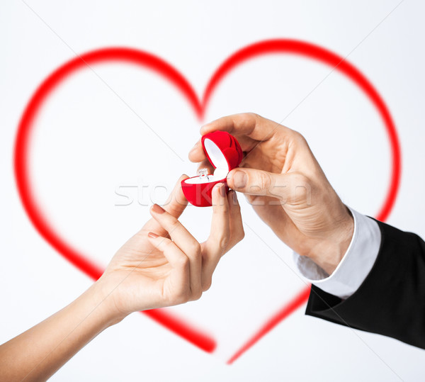 couple hands with engagement ring Stock photo © dolgachov