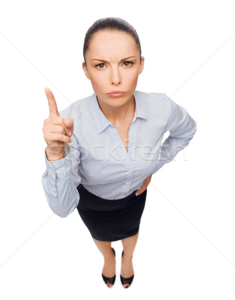 angry businesswoman with finger up Stock photo © dolgachov