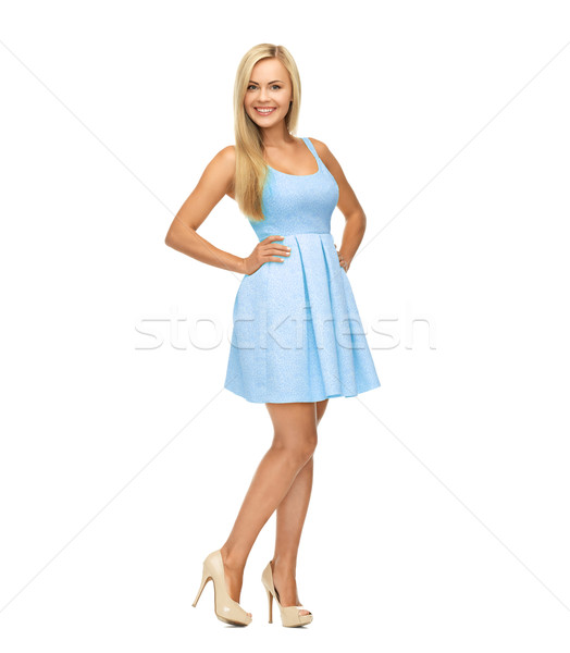 young woman in blue dress and high heels Stock photo © dolgachov
