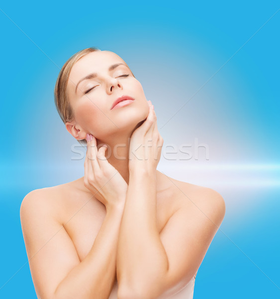 Stock photo: beautiful woman touching her face with closed eyes