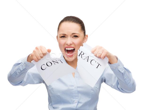 serious businesswoman tearing contract Stock photo © dolgachov
