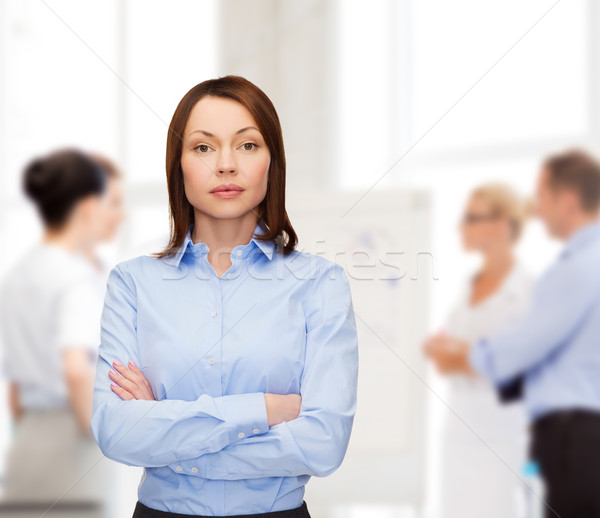 smiling businesswoman with crossed arms at office Stock photo © dolgachov