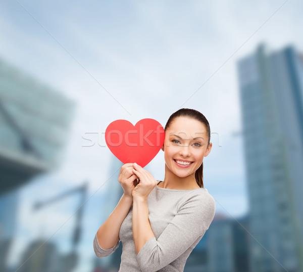 笑みを浮かべて アジア 女性 赤 中心 幸福 ストックフォト © dolgachov
