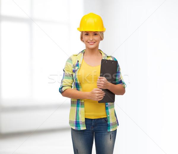 笑顔の女性 ヘルメット クリップボード 修復 建設 メンテナンス ストックフォト © dolgachov