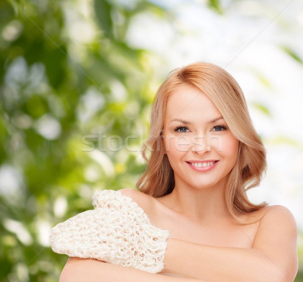 smiling woman with exfoliation glove Stock photo © dolgachov