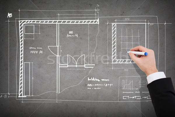 close up of businessman drawing blueprint Stock photo © dolgachov