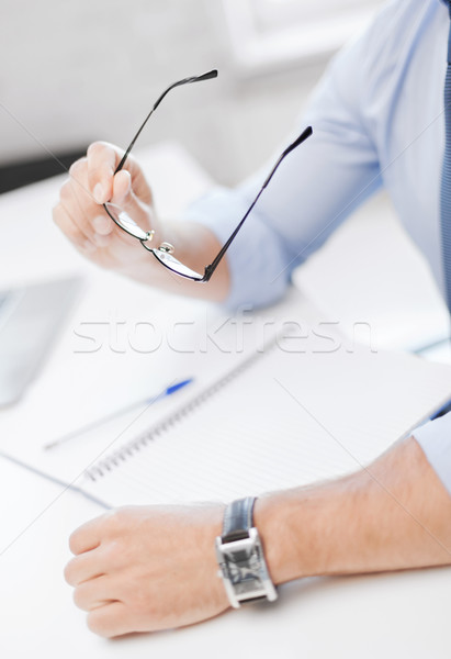 businessman with spectacles writing in notebook Stock photo © dolgachov