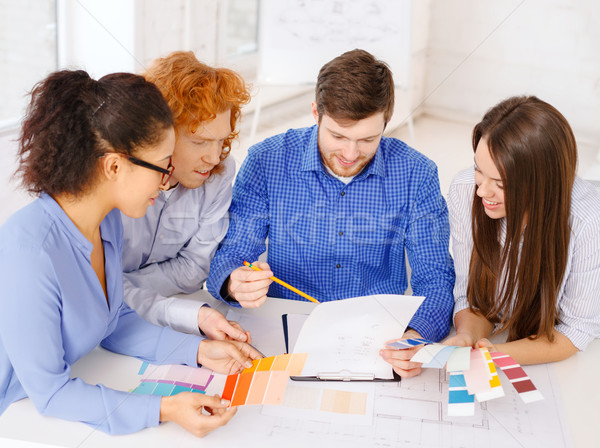 team with color samples and blueprint at office Stock photo © dolgachov