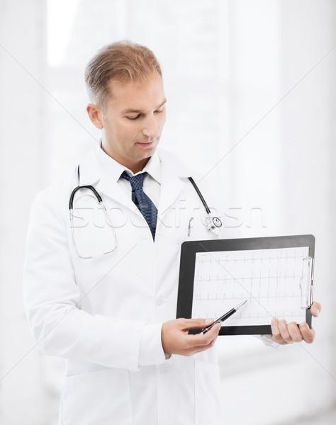 Médico do sexo masculino estetoscópio cardiograma saúde médico Foto stock © dolgachov