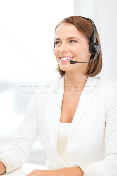 Gülen kadın yardım hattı operatör kulaklık iş Stok fotoğraf © dolgachov