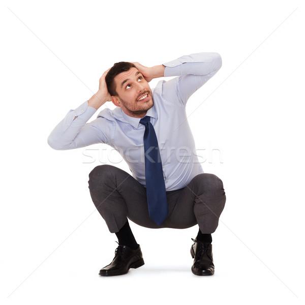 Glimlachend zakenman hurken vloer business onderwijs Stockfoto © dolgachov