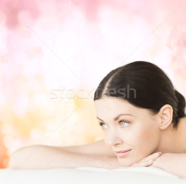 smiling woman in spa salon Stock photo © dolgachov