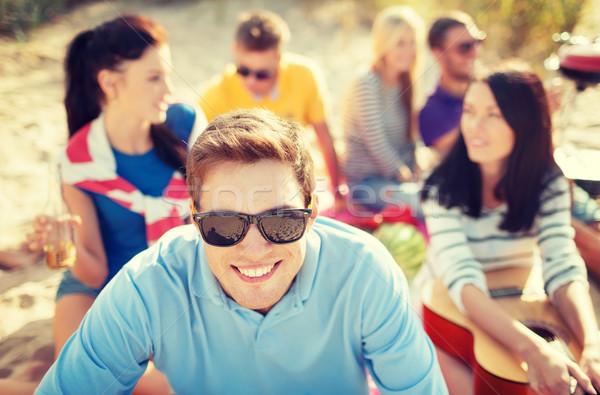 Gülen adam güneş gözlüğü plaj yaz tatil Stok fotoğraf © dolgachov
