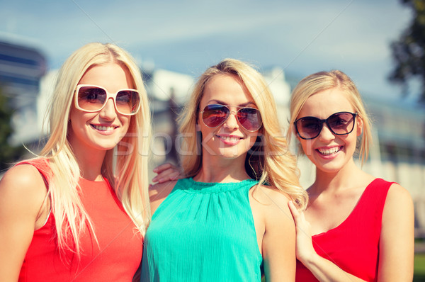 three beautiful women in the city Stock photo © dolgachov