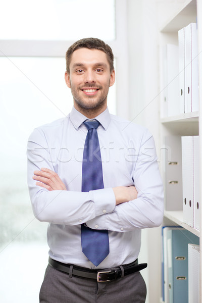 handsome businessman with crossed arms at office Stock photo © dolgachov