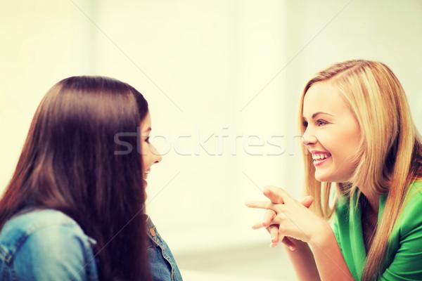Diák lányok pletykál iskola oktatás barátok Stock fotó © dolgachov