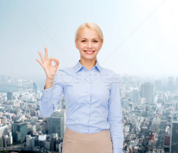 smiling businesswoman showing ok-sign with hand Stock photo © dolgachov