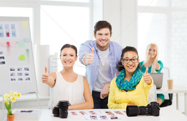 smiling team with photocamera in office Stock photo © dolgachov