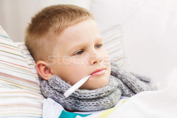 ill boy with flu at home Stock photo © dolgachov