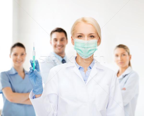 Lekarza maska strzykawki wstrzykiwań opieki zdrowotnej Zdjęcia stock © dolgachov