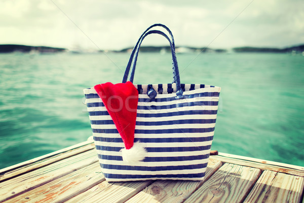 close up of beach bag and santa helper hat Stock photo © dolgachov