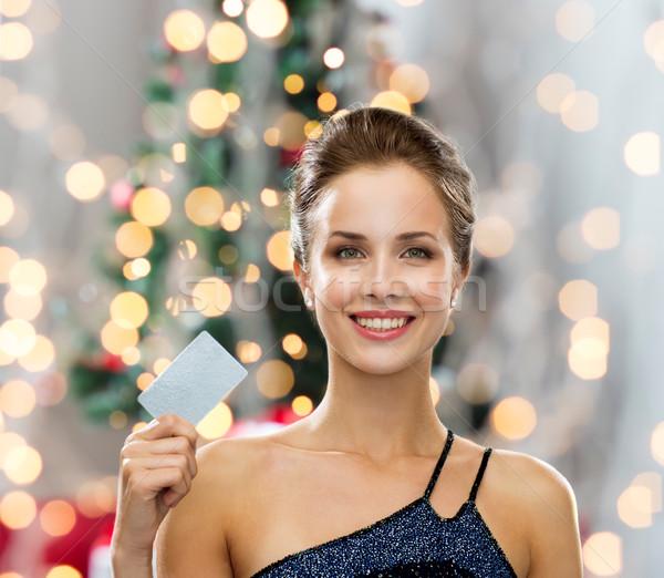улыбающаяся женщина вечернее платье кредитных карт торговых богатство Сток-фото © dolgachov