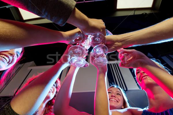 笑みを浮かべて 友達 眼鏡 シャンパン クラブ パーティ ストックフォト © dolgachov