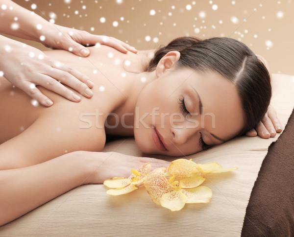 Stock photo: beautiful young woman in spa salon getting massage