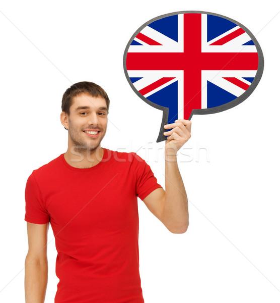 smiling man with text bubble of british flag Stock photo © dolgachov