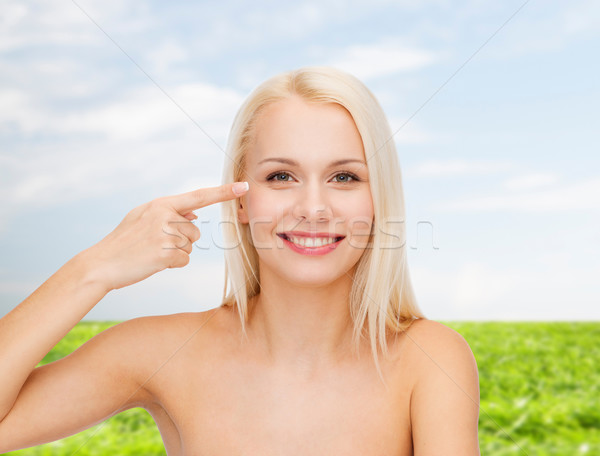 Bela mulher tocante olho saúde beleza cara Foto stock © dolgachov