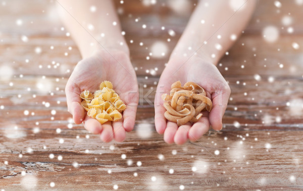 close up of hands with different pasta variations Stock photo © dolgachov