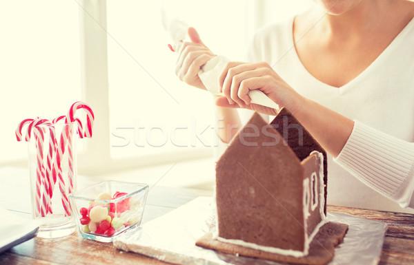 Donna pan di zenzero case cottura Foto d'archivio © dolgachov