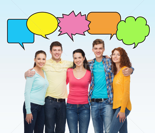 Groep glimlachend tieners tekst bubbels vriendschap Stockfoto © dolgachov