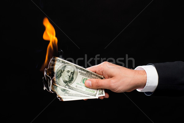 close up of male hand holding burning dollar money Stock photo © dolgachov