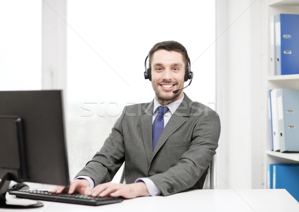helpline operator with headphones and computer Stock photo © dolgachov