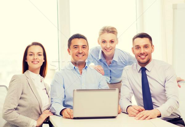 ビジネスチーム 作業 ノートパソコン オフィス ビジネス 笑みを浮かべて ストックフォト © dolgachov