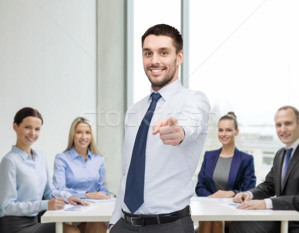 handsome businessman pointing finger at you Stock photo © dolgachov