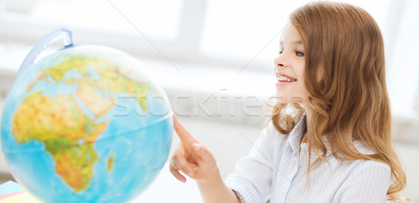 smiling student girl with globe at school Stock photo © dolgachov