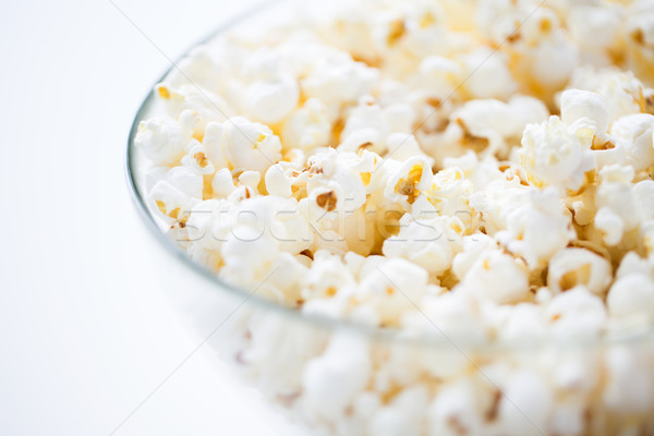 close up of popcorn in glass bowl Stock photo © dolgachov