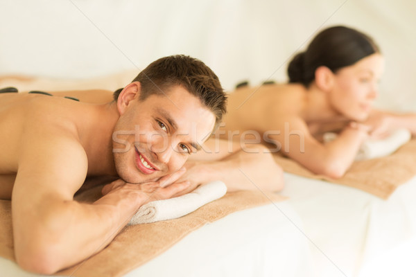 Stock photo: couple in spa with hot stones