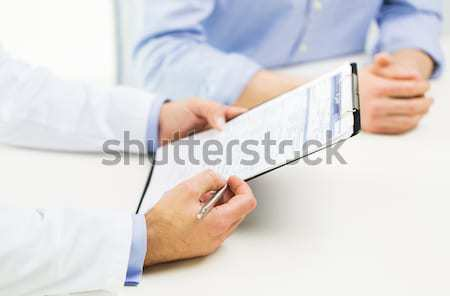 close up of male doctor and patient with tablet pc Stock photo © dolgachov