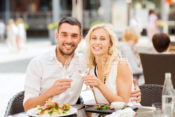 happy couple clinking glasses at restaurant lounge Stock photo © dolgachov