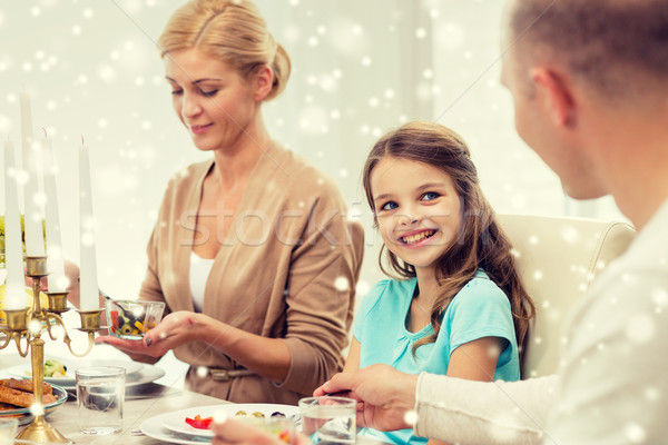 Stock photo: smiling family having holiday dinner at home