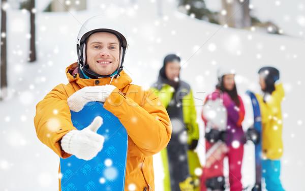 Boldog fiatalember hódeszka mutat remek tél Stock fotó © dolgachov