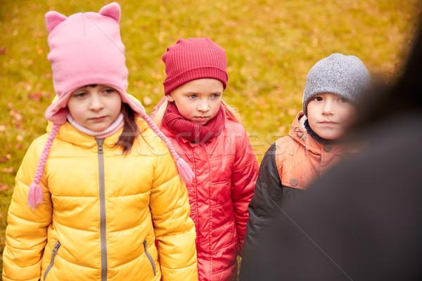 sad kids being blamed for misbehavior outdoors Stock photo © dolgachov